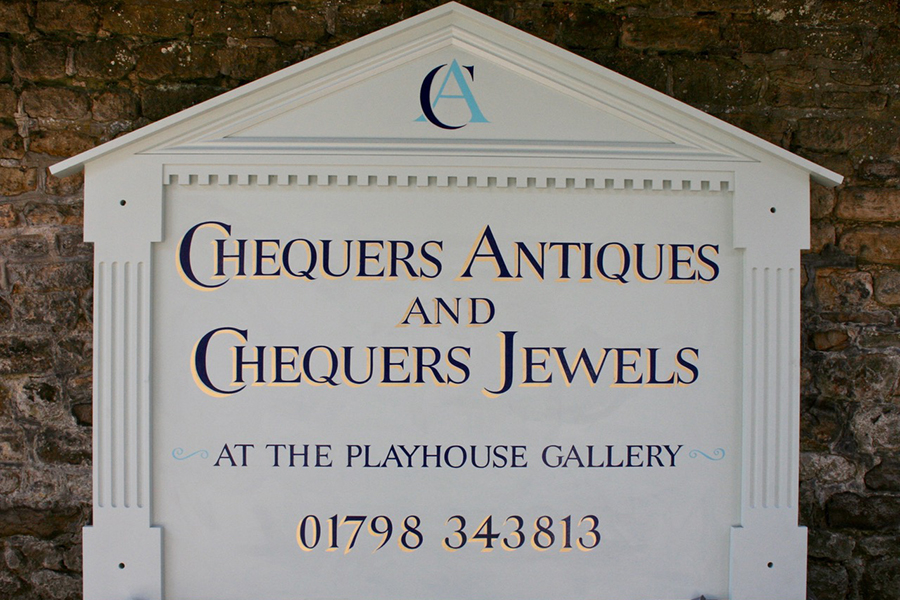 Hand painted sign for Chequers Antiques and Chequers Jewels